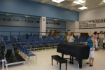 Donna Turnbeaugh Stec at the grand piano in the new choir. New since we were there.  Notice all the plaques and trophies